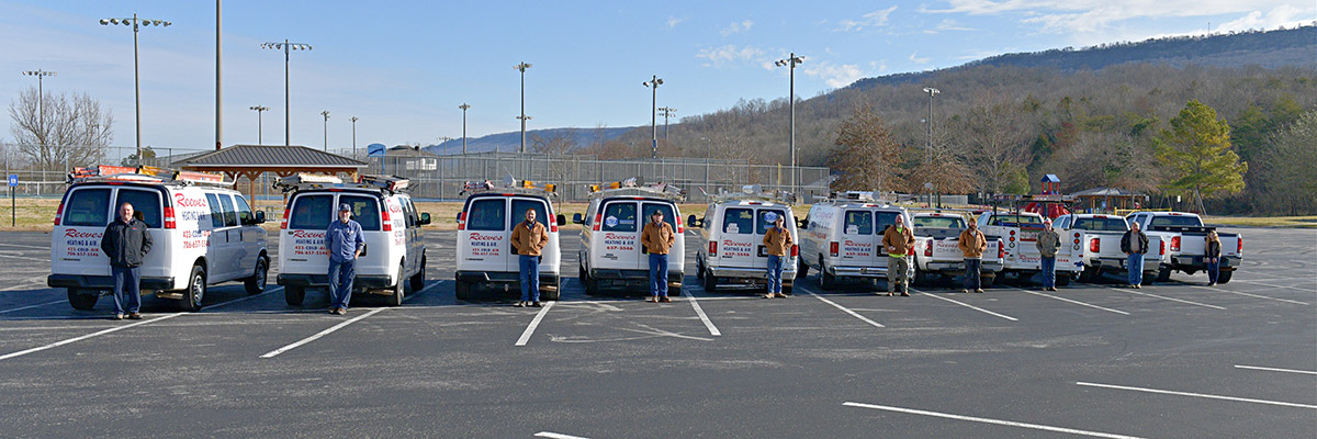 Crew by their trucks